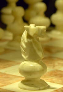 Close-up-of-marble-chess-set-with-knight-advancing-205x300